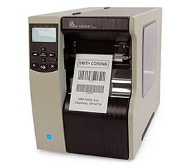 An industrial Zebra printer with a barcode label