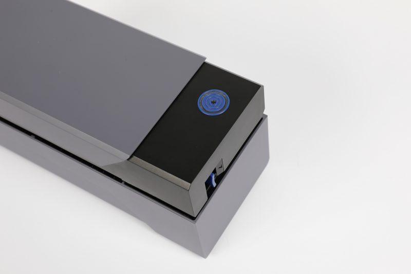 The calibration button on Rollo thermal printer