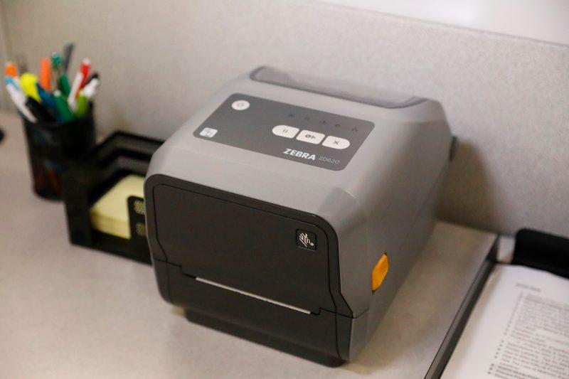 A Zebra ZD620 thermal printer on a desk