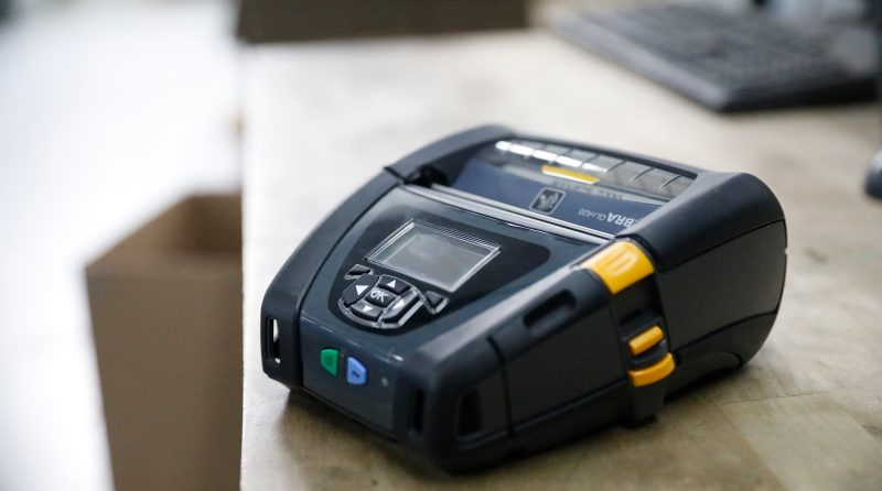 A Zebra QLn420 mobile printer sits ready to print direct thermal labels