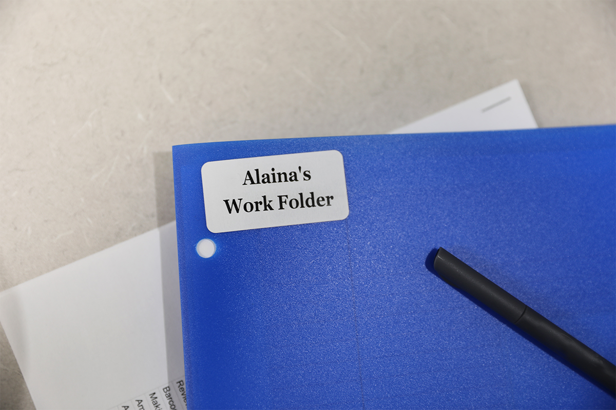 An all temperature adhesive label is used on a folder for organization