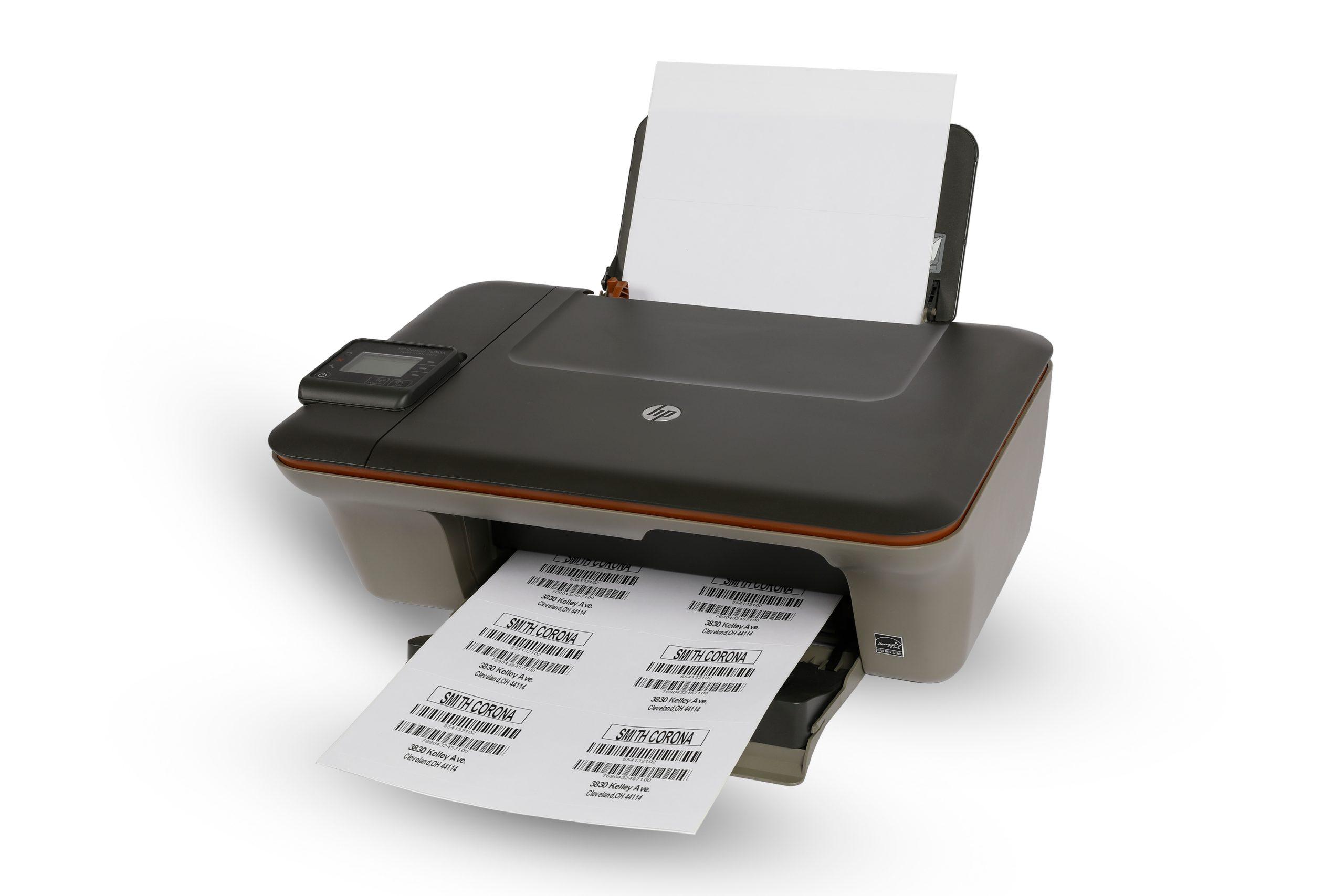 A desktop laser printer prints out laser labels onto a sheet