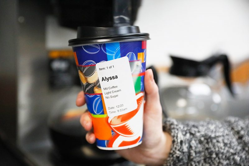 A direct thermal label is applied to a disposable coffee cup purchased at a shop or popular chain