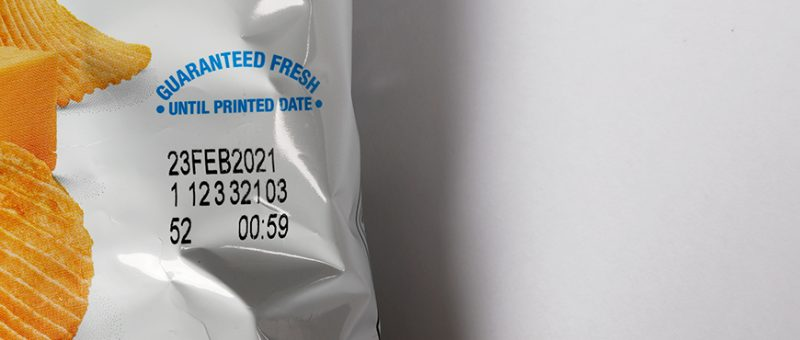 A close up image of an expiration date printed on a bag of potato chips printed with a near edge thermal printer