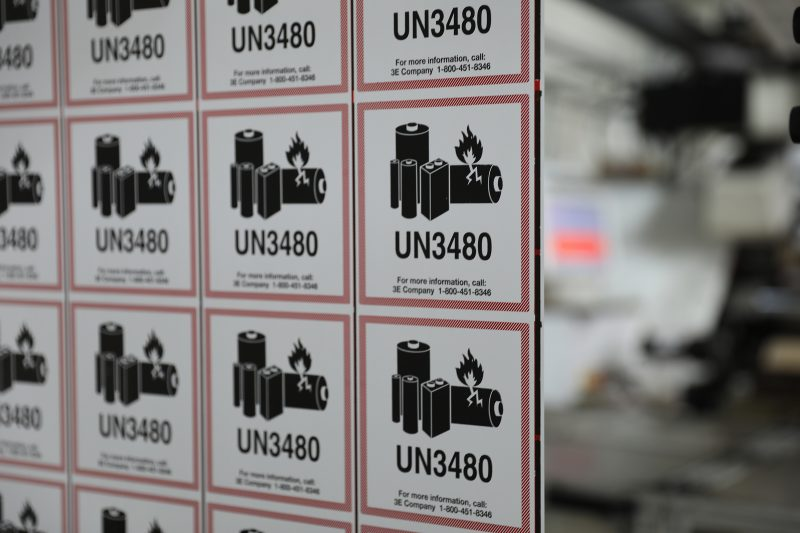 An array of UN3481 lithium-ion battery labels are printed on an ETI machine
