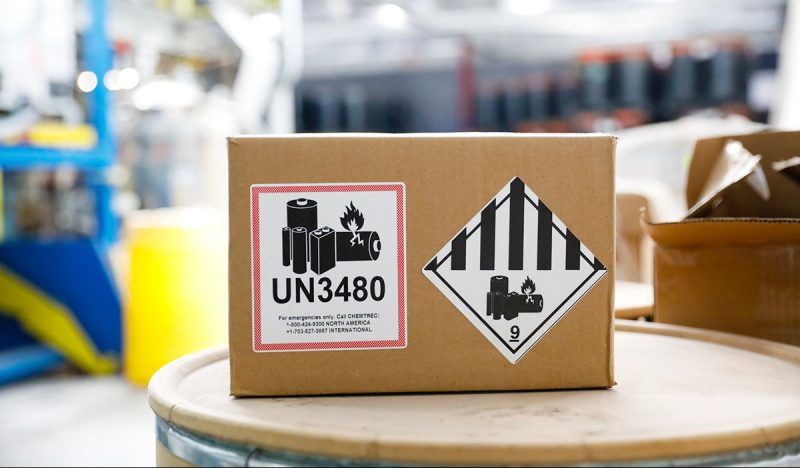 A box with a lithium-ion UN3480 label and a black and white class 9 hazard label