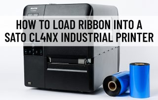 A SATO CL4NX industrial printer with thermal ribbon