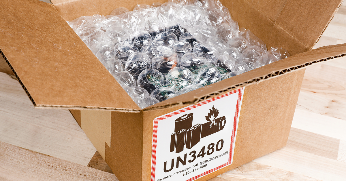 A battery is wrapped in inner packaging and placed within a box with a UN 3280 battery label on it