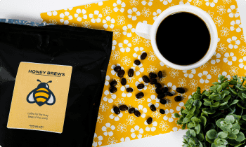 Bag of coffee with label featuring a bee