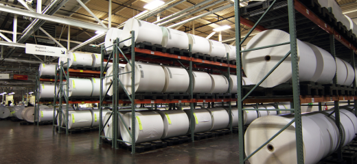 Large racks containing giant rolls of label laminate material