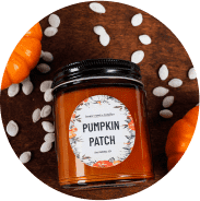 Candle with label reading pumpkin patch