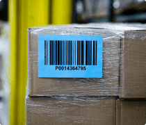 Packages with a large blue bardcode label